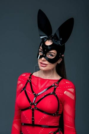 Kinky woman in sexy costume isolated on grey