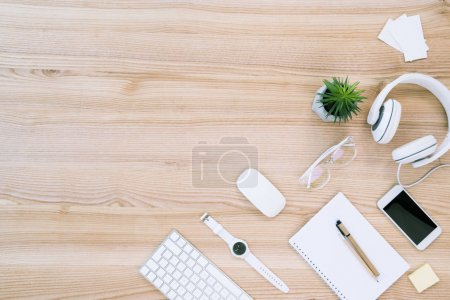 Photo for Flat lay with various digital devices, watch and blank notebook on workplace - Royalty Free Image