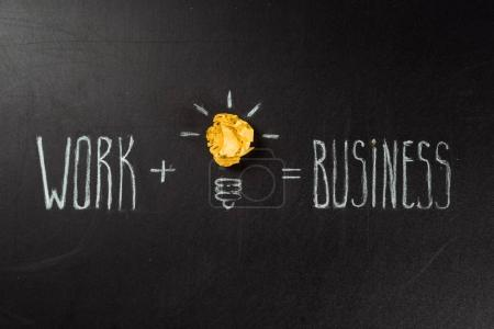 Photo for Business concept made of light bulb symbol and work and business inscription on blackboard - Royalty Free Image