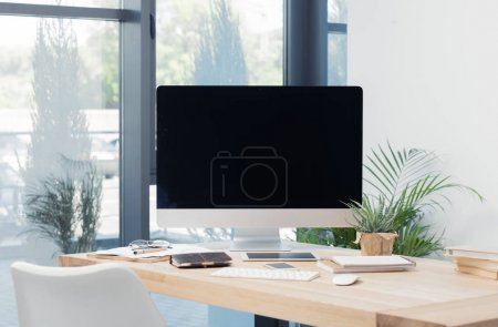 Photo for Blank computer screen, smartphone, tablet and notebooks on workplace in office - Royalty Free Image