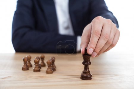 Photo for Cropped view of businessman holding chess figure in hand - Royalty Free Image