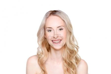 Woman with braces smiling cheerfully