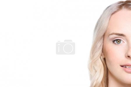 Photo for Half shot of a young woman face isolated on white. - Royalty Free Image