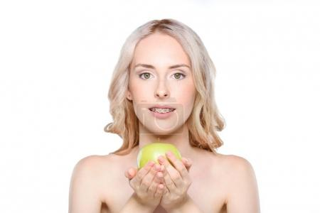Woman holding apple in hands