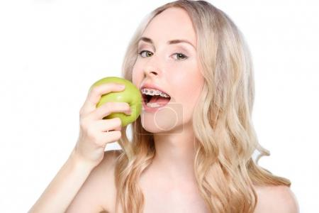 Woman taking bite of apple