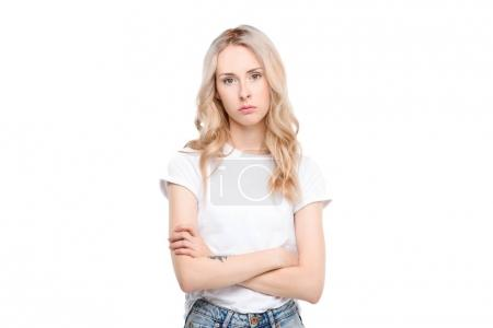 Photo for Half length shot of a young caucasian woman with arms crossed looking sad. - Royalty Free Image