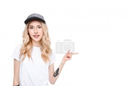 Young woman pointing to side