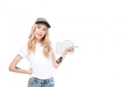 Photo for Half length shot of a young caucasian woman in casual clothes pointing to the side. - Royalty Free Image