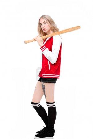 Woman posing with baseball bat
