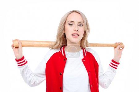 Woman holding baseball bat behind shoulders