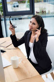 Pregnant businesswoman with call center headset