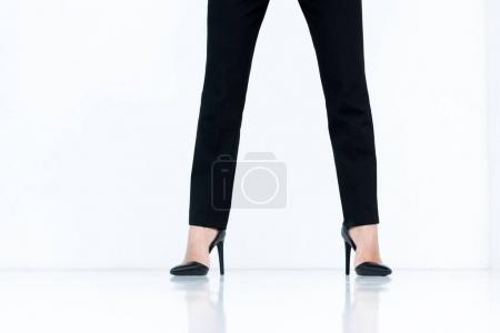 Photo for Cropped shot of businesswoman in black pants and high heels - Royalty Free Image