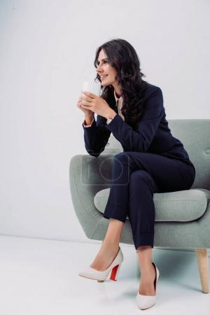 businesswoman with cup of hot drink