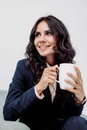 Photo for Close-up portrait of young businesswoman with cup of hot drink - Royalty Free Image