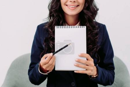 Businesswoman pointing at notebook