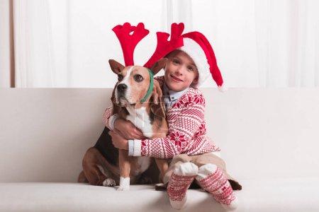 boy and his dog on christmas