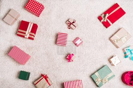 Photo for Top view of various christmas gifts on floor - Royalty Free Image