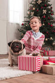 boy with cute pug on christmas