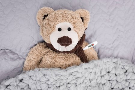 teddy bear with thermometer