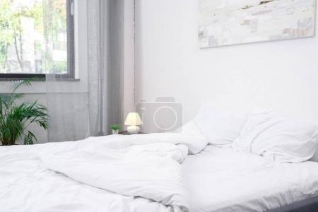 Photo for Empty bedroom with white bed with pillows - Royalty Free Image