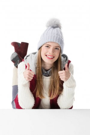 girl in hat with thumbs up