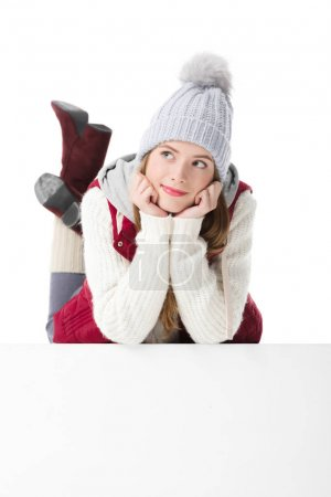 thoughtful girl in winter clothes
