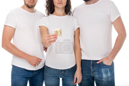 woman holding condom with men on sides