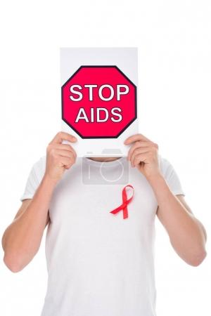 man with stop aids banner