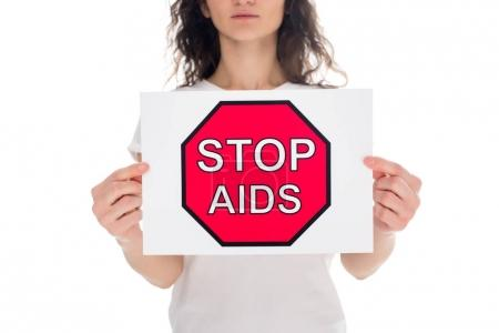 woman with stop aids banner