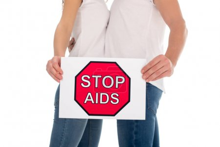 couple with stop aids banner