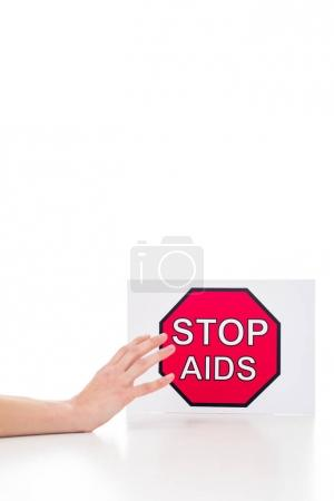 person reaching for stop aids banner