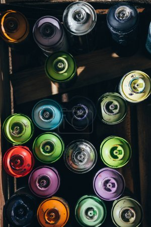 Photo for Top view of cans with colorful aerosol paint - Royalty Free Image