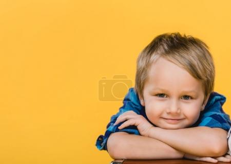 Photo for Portrait of smiling little boy in shirt looking at camera isolated on yellow - Royalty Free Image
