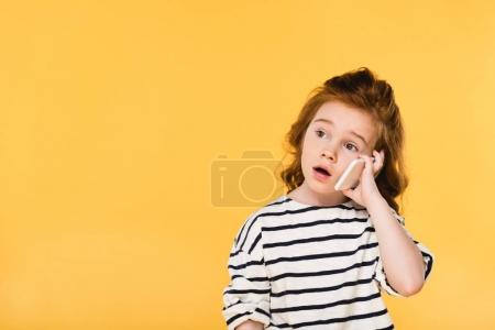 Photo for Portrait of cute child talking on smartphone isolated on yellow - Royalty Free Image