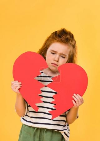 Photo for Portrait of sad child with broken red paper heart isolated on yellow, st valentines day concept - Royalty Free Image