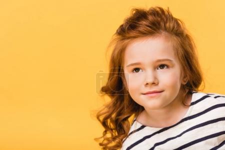 portrait of pretty kid looking away isolated on yellow