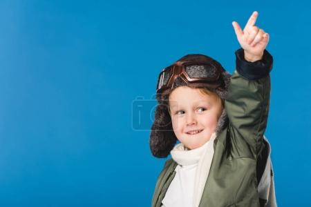 portrait of preteen boy in pilot costume isolated on blue