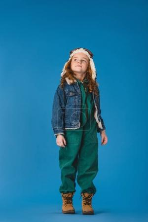 Photo for Adorable preteen kid in pilot costume looking away isolated on blue - Royalty Free Image