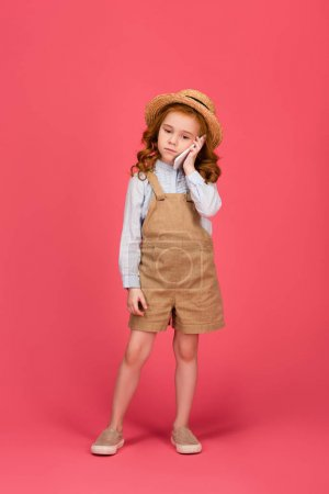 little child talking on smartphone isolated on pink