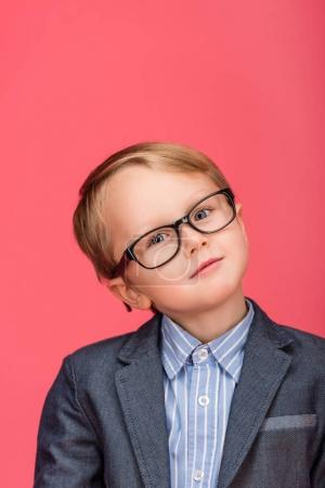 portrait of cute little boy in eyeglasses isolated on pink