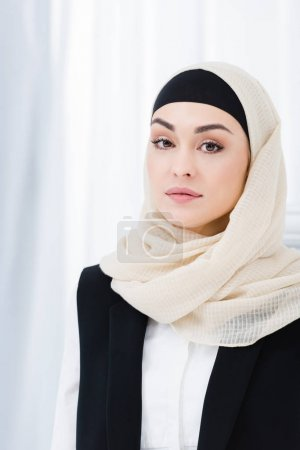 portrait of beautiful businesswoman in hijab looking at camera