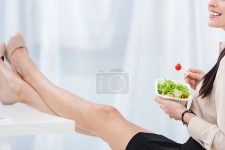 Photo for Partial view of businesswoman with take away food at workplace in office - Royalty Free Image