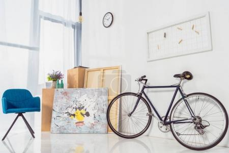 Bicycle and blue chair in modern light room