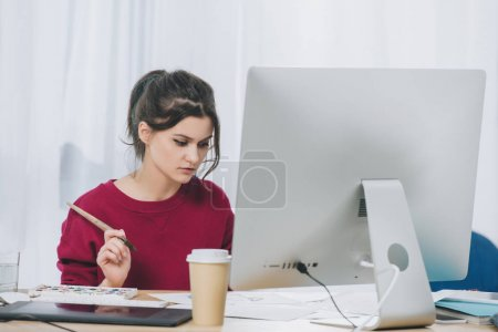 Female artist working with illustrations by computer