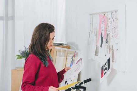 Pretty lady working with sketches and mood board