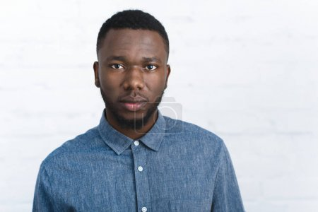 Confident african american man by white wall