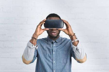 Handsome african american man wearing vr glasses