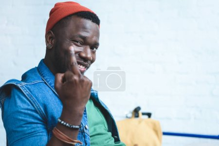 Handsome african american man showing middle finger