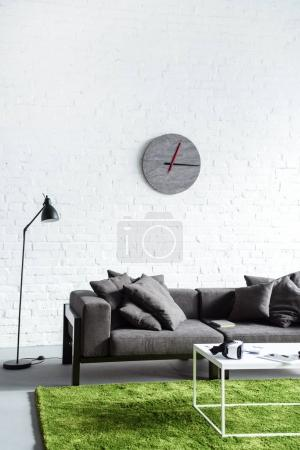 Digital gadgets in cozy interior with modern grey sofa