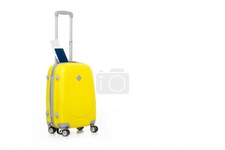 Photo pour Valise jaune avec passeport et billet isolé sur blanc - image libre de droit